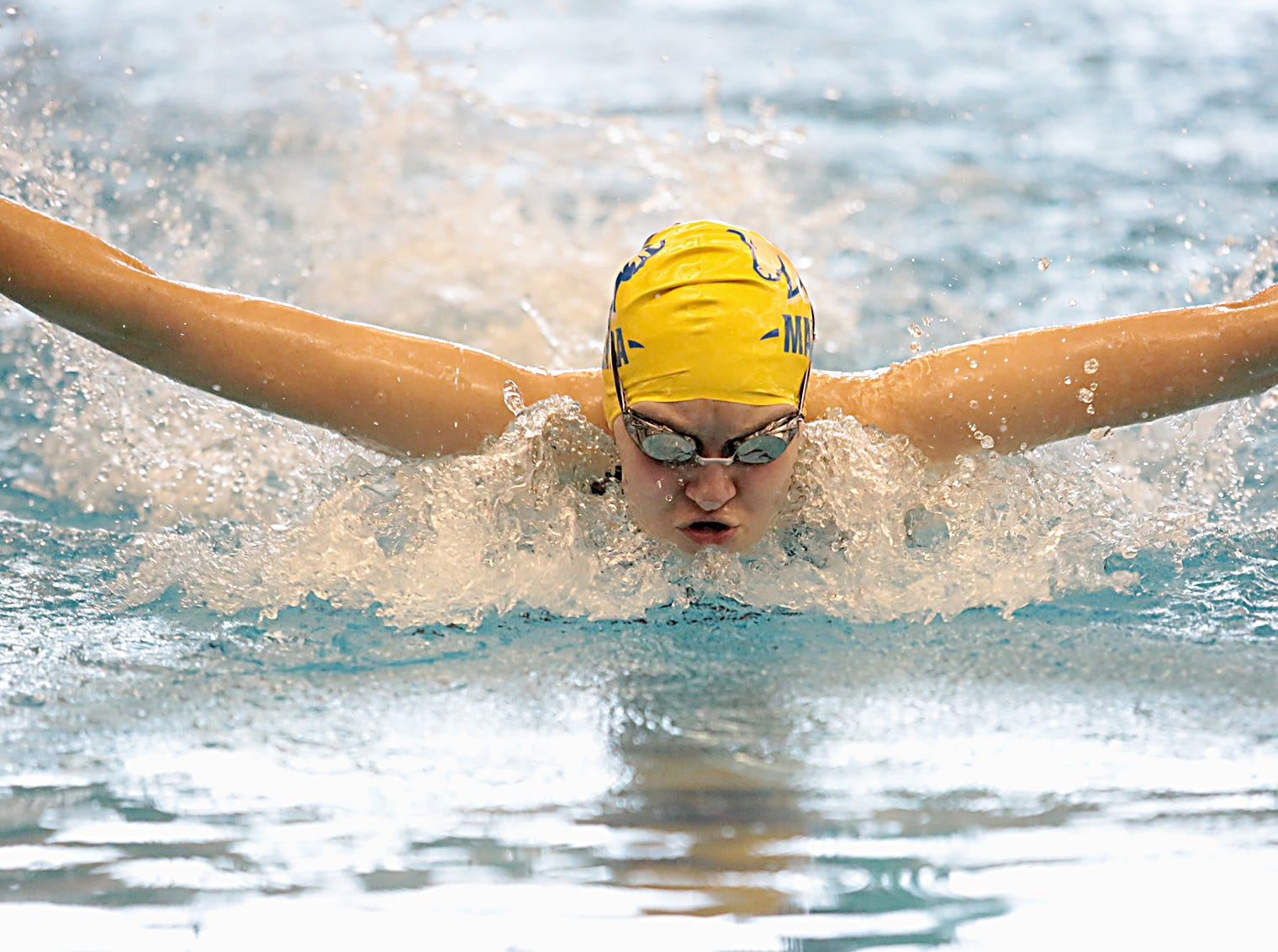 Izzy Evans, from Madeira, competes in the 100-yard butterfly during the Division I and II girls sectionals at Mason High School Saturday, Feb. 9, 2019.