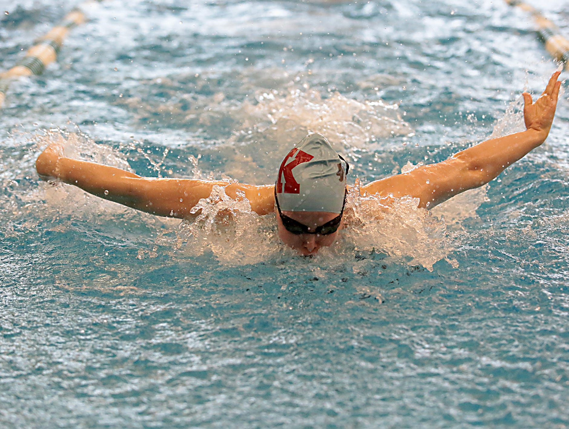 Brynna Wolfe, from Kings, competes in the 100-yard butterfly during the Division I and II sectionals at Mason High School Saturday, Feb. 9, 2019.