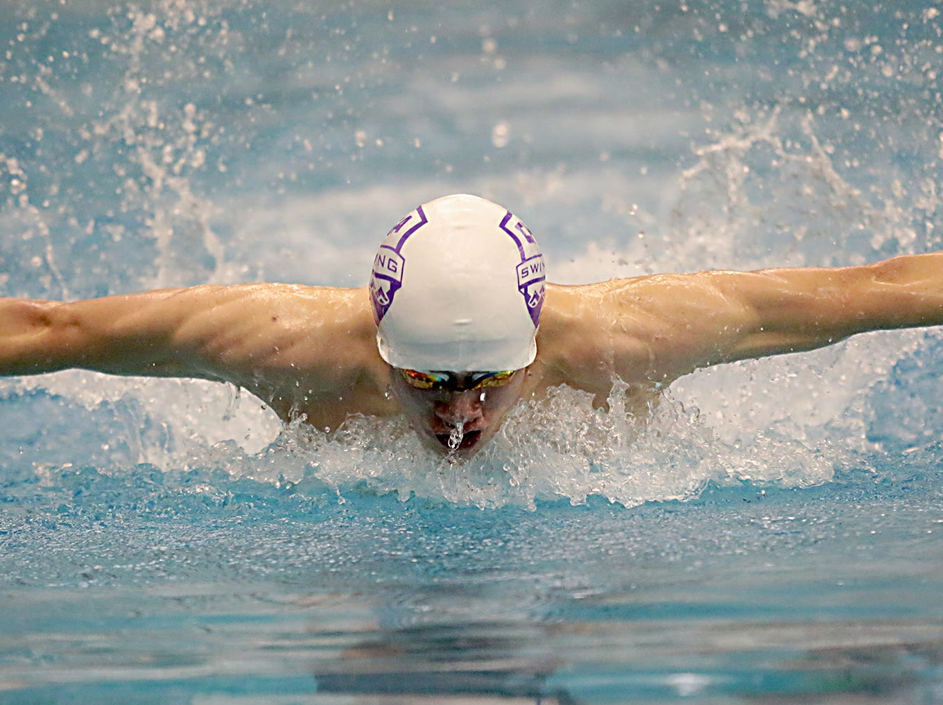 A.J. Vibberts, from Cincinnati Hills Christian Academy, competes in the 100-yard butterfly during the Division I and Division II sectionals at Mason High School in Mason Friday, Feb. 8, 2019.