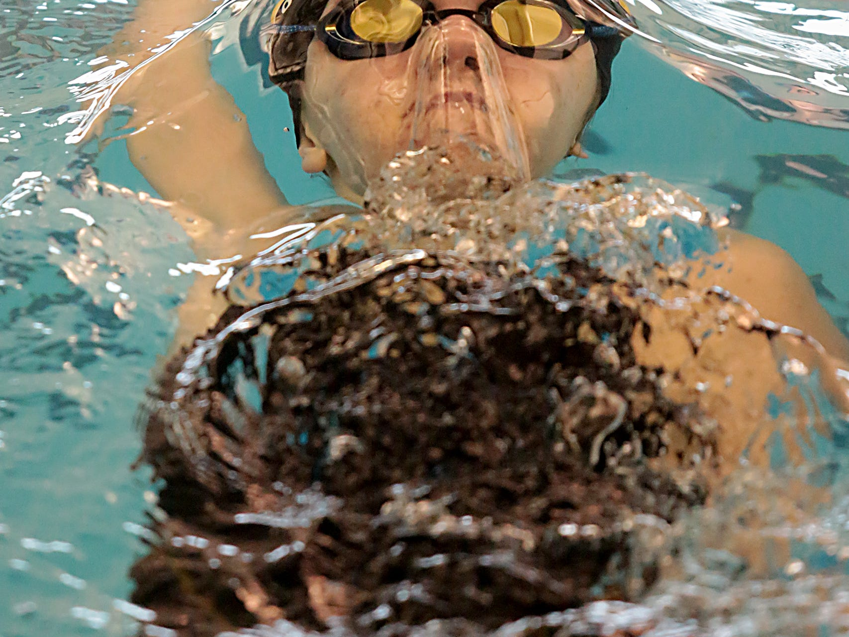 Grace Larrick, from Sycamore, competes in the 200-yard IM during the Division I and II sectionals at Mason High School Saturday, Feb. 9, 2019.