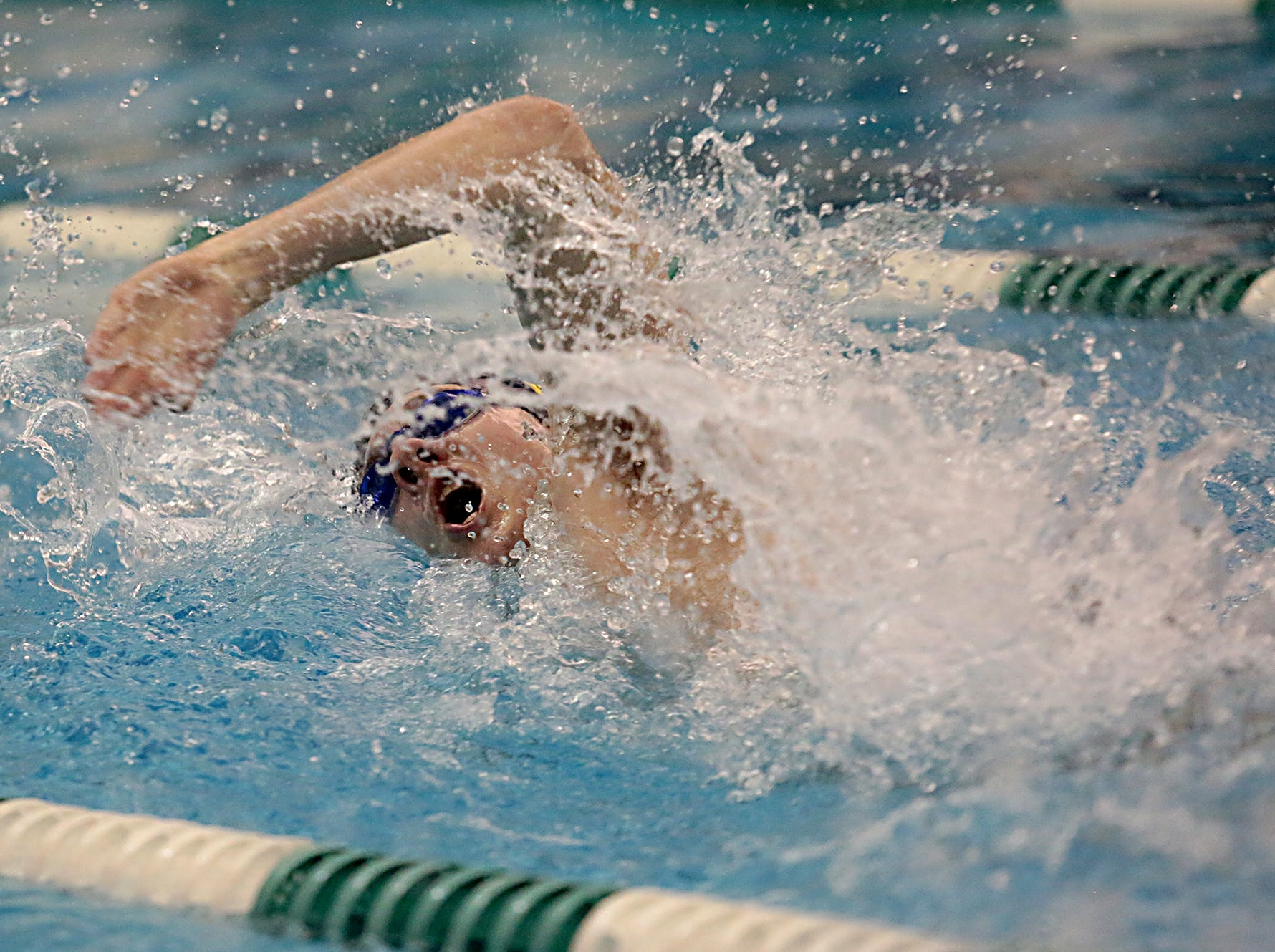 John Pappalardo, from Moeller, competes in the 50-yard freestyle during the Division I and Division II sectionals at Mason High School in Mason Friday, Feb. 8, 2019.