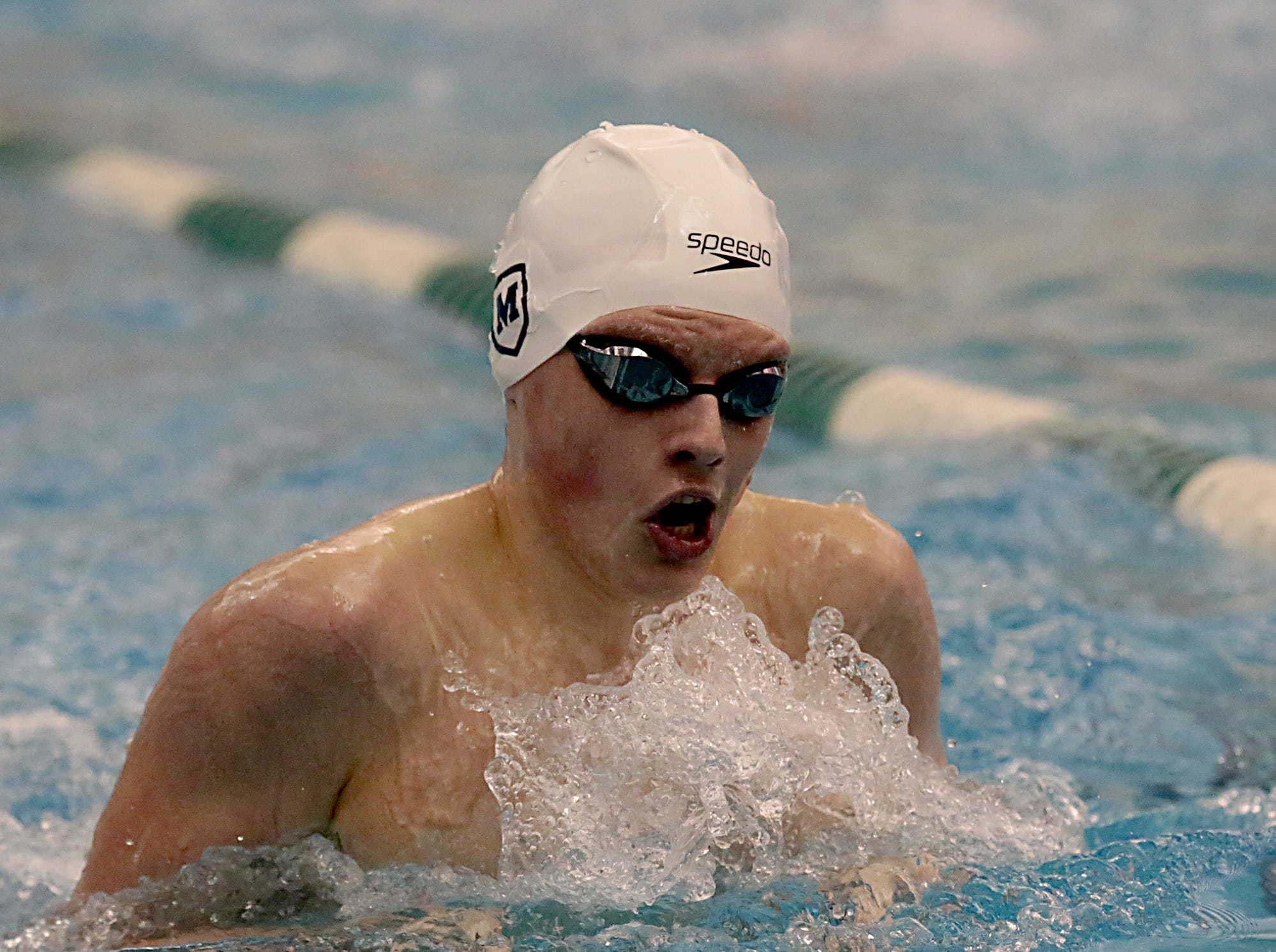 Alex Koetter, from Moeller, competes in the 200-yard IM during the Division I and Division II sectionals at Mason High School in Mason Friday, Feb. 8, 2019.