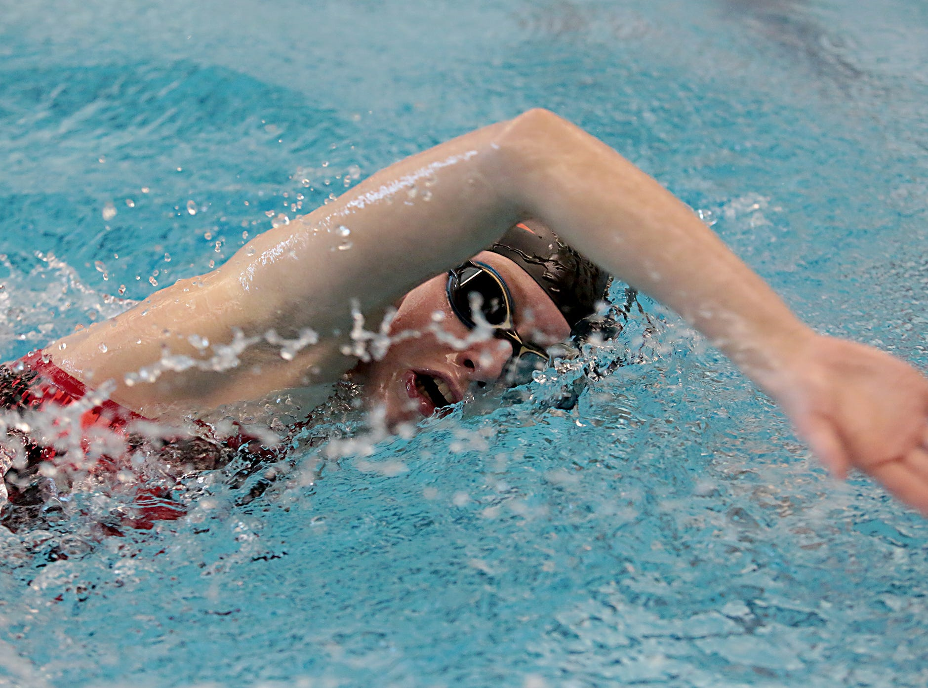 Gretchen Feldkamp, from Milford, competes in the 200-yard freestyle during the Division I and II sectionals at Mason High School Saturday, Feb. 9, 2019.