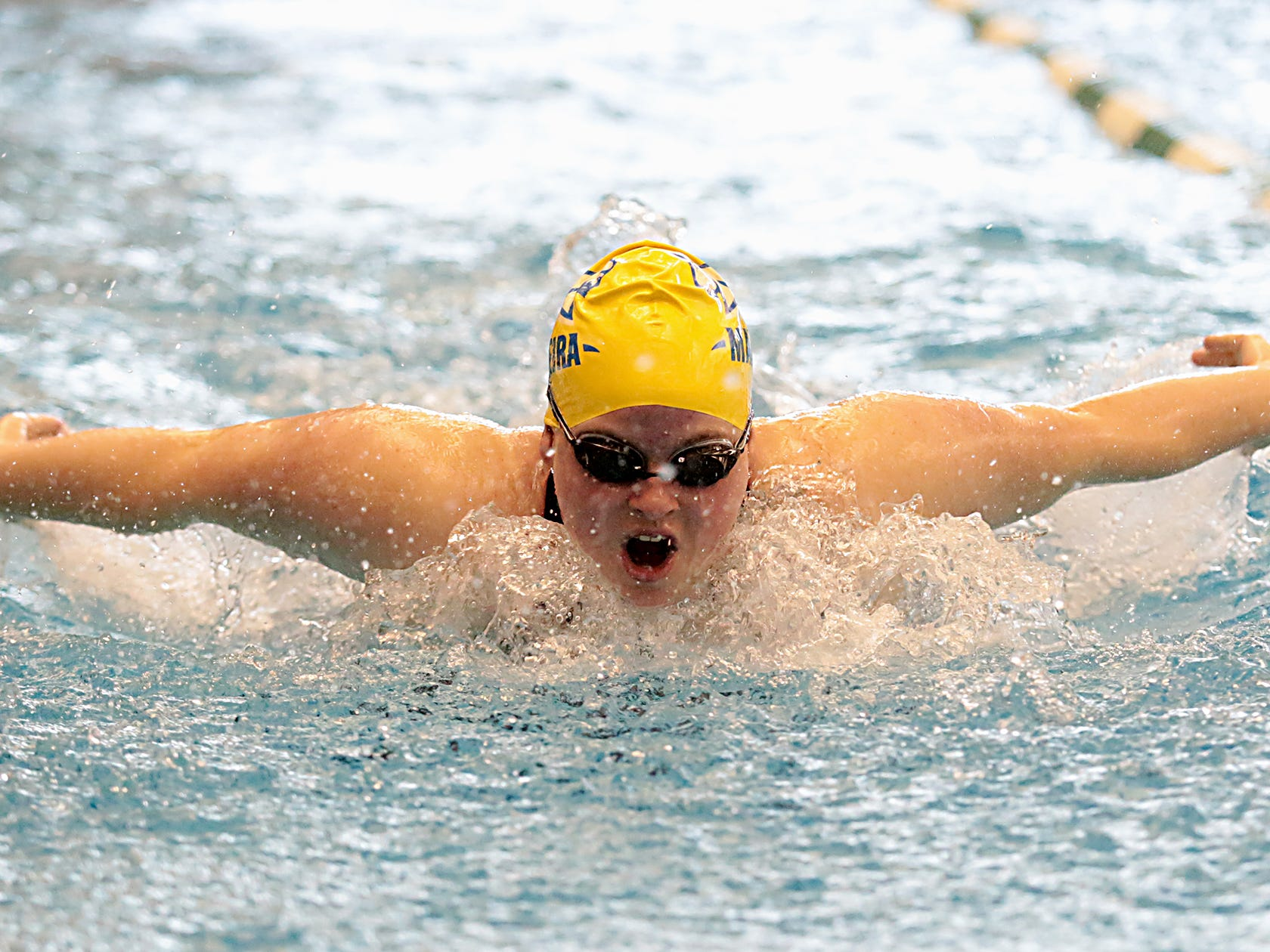 Helen Lewis, from Madeira, competes in the 200-yard IM during the Division I and II sectionals at Mason High School Saturday, Feb. 9, 2019.