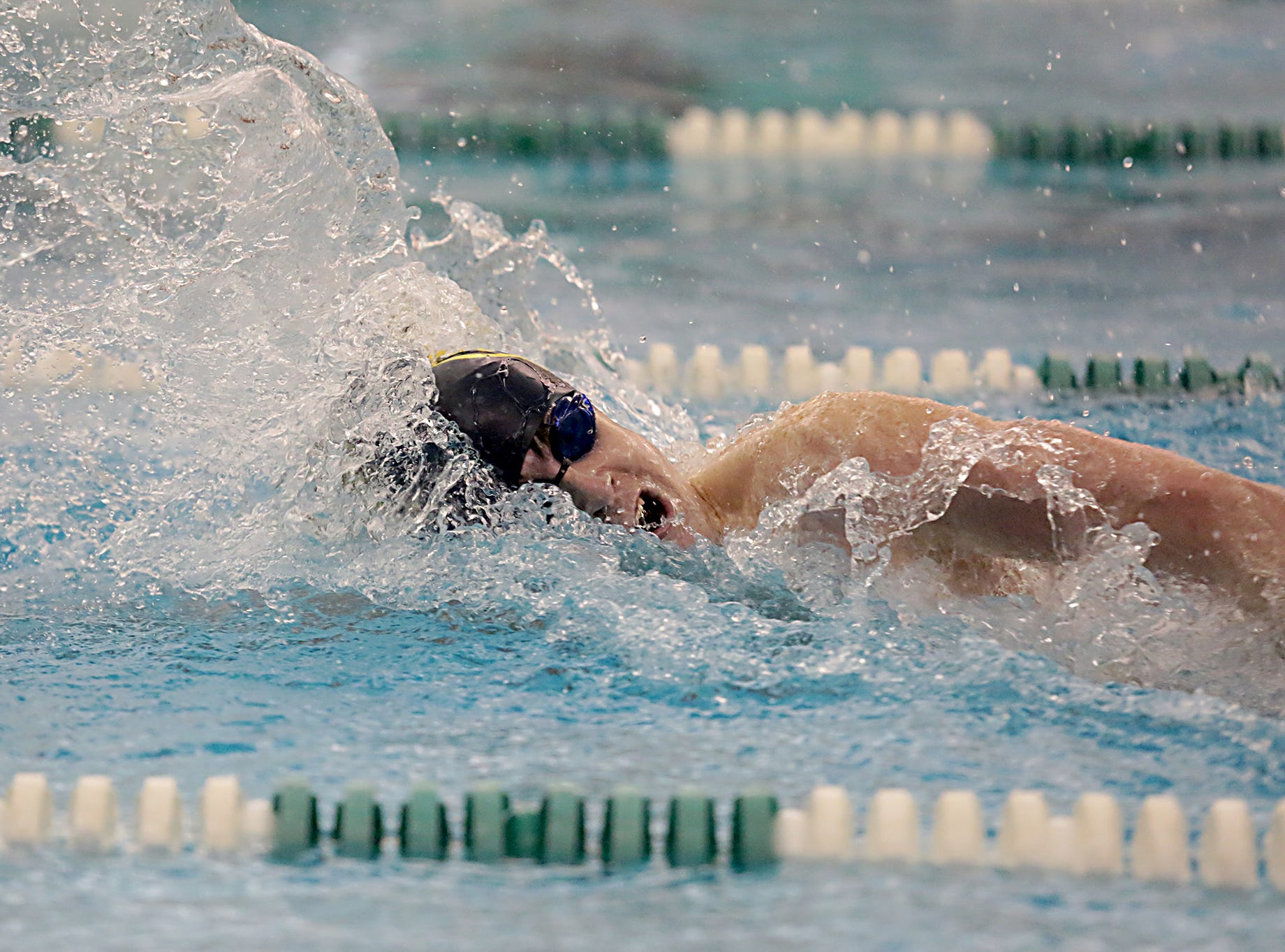 Will Leary, from Moeller, competes in the 100-yard freestyle during the Division I and Division II sectionals at Mason High School in Mason Friday, Feb. 8, 2019.