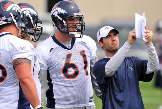 Denver Broncos linemen review a play with Brian Callahan, when he was a coaching assistant in 2010. He was named the Bengals offensive coordinator at age 34 this week.