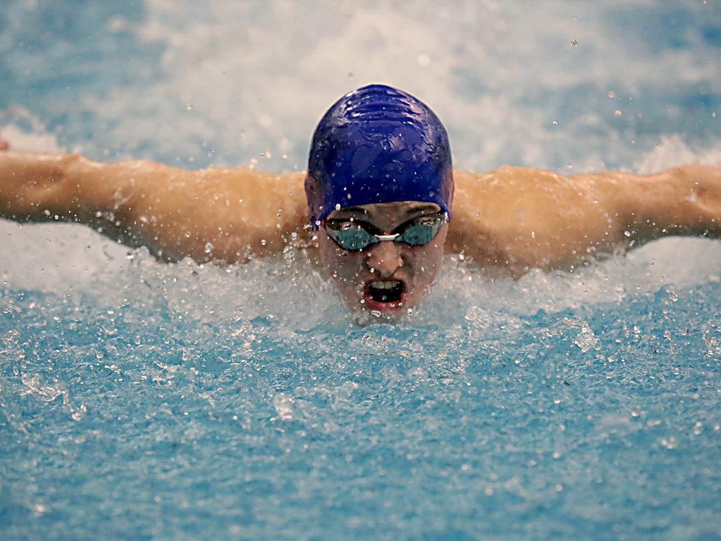 Nate Grant, from Reading, competes in the 100-yard butterfly during the Division I and Division II sectionals at Mason High School in Mason Friday, Feb. 8, 2019.