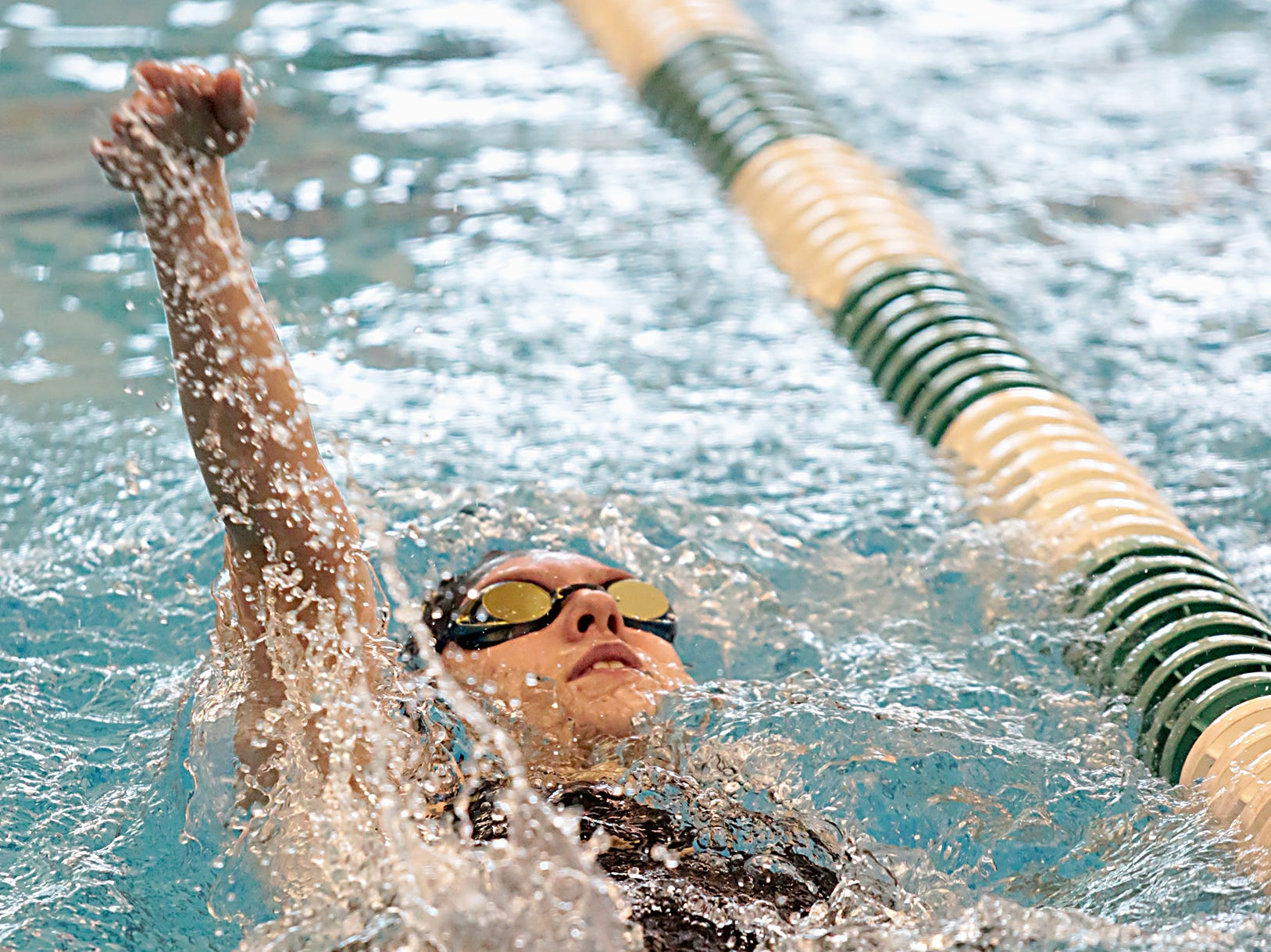 Grace Larrick, from Sycamore, competes in the 200-yard IM during the Division I and II girls sectionals at Mason High School Saturday, Feb. 9, 2019.