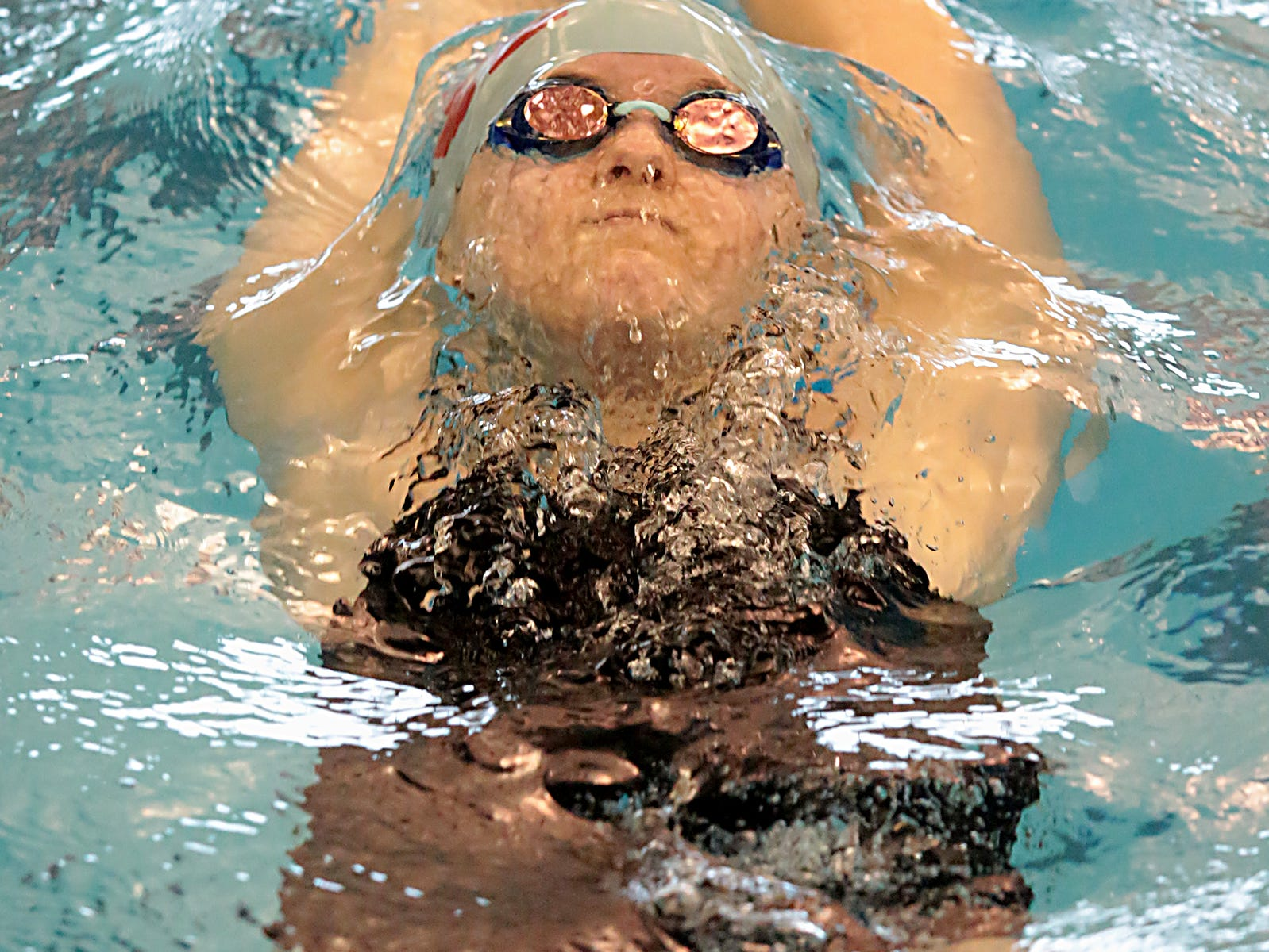Alicia Barnett, from Kings, competes in the 200-yard IM during the Division I and II sectionals at Mason High School Saturday, Feb. 9, 2019.