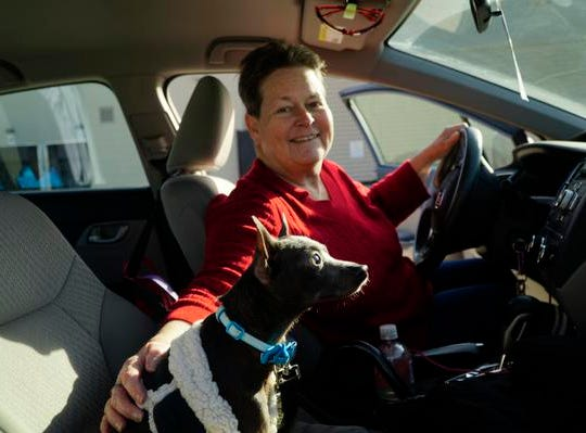Patricia Holbrook prepares to take her new dog Corey home after the My Furry Valentine adoption event, Saturday, Feb. 9, 2019.