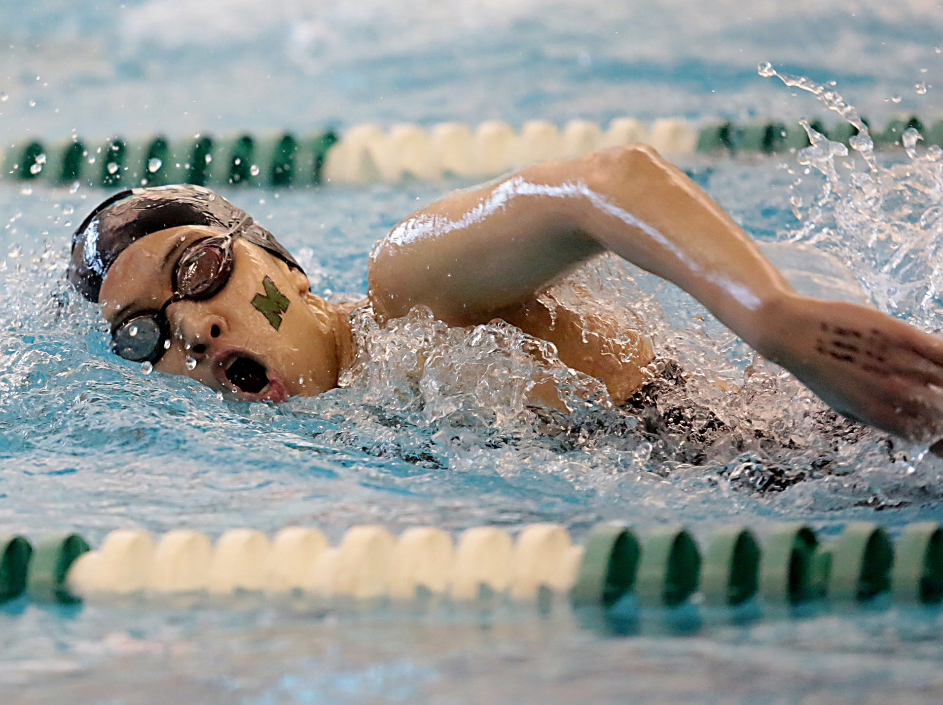Emily Yu, from Mason, competes in the 200-yard freestyle during the Division I and II sectionals at Mason High School Saturday, Feb. 9, 2019.