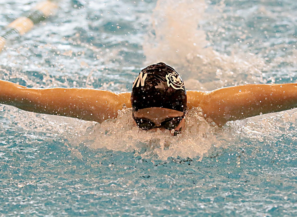 Harna Minezawa, from Mason, competes in the 100-yard butterfly during the Division I and II sectionals at Mason High School Saturday, Feb. 9, 2019.