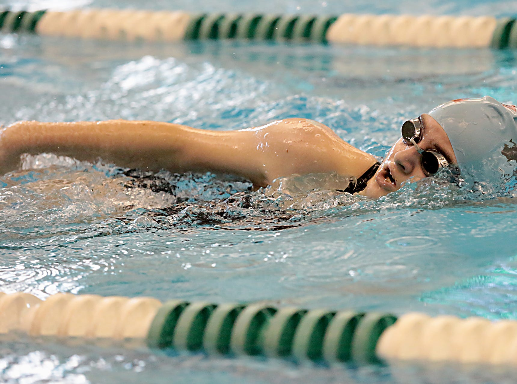 Josephine Zotter, from Kings, competes in the 200-yard freestyle during the Division I and II sectionals at Mason High School Saturday, Feb. 9, 2019.