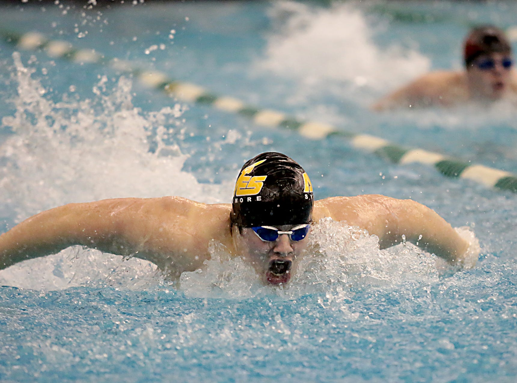 Declan Skinner, from Sycamore, competes in the 100-yard butterfly during the Division I and Division II sectionals at Mason High School in Mason Friday, Feb. 8, 2019.