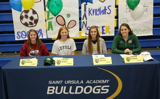 St. Ursula honored four seniors who committed to play college sports Feb. 6 for Signing Day. They are, from left: Lexi Kaeser, soccer, University of South Carolina, Beaufort; Taylor Kuncl, tennis, Loyola University, Maryland; Drew Mason, soccer, Marian University; and Maddie Young, soccer, Ohio University.