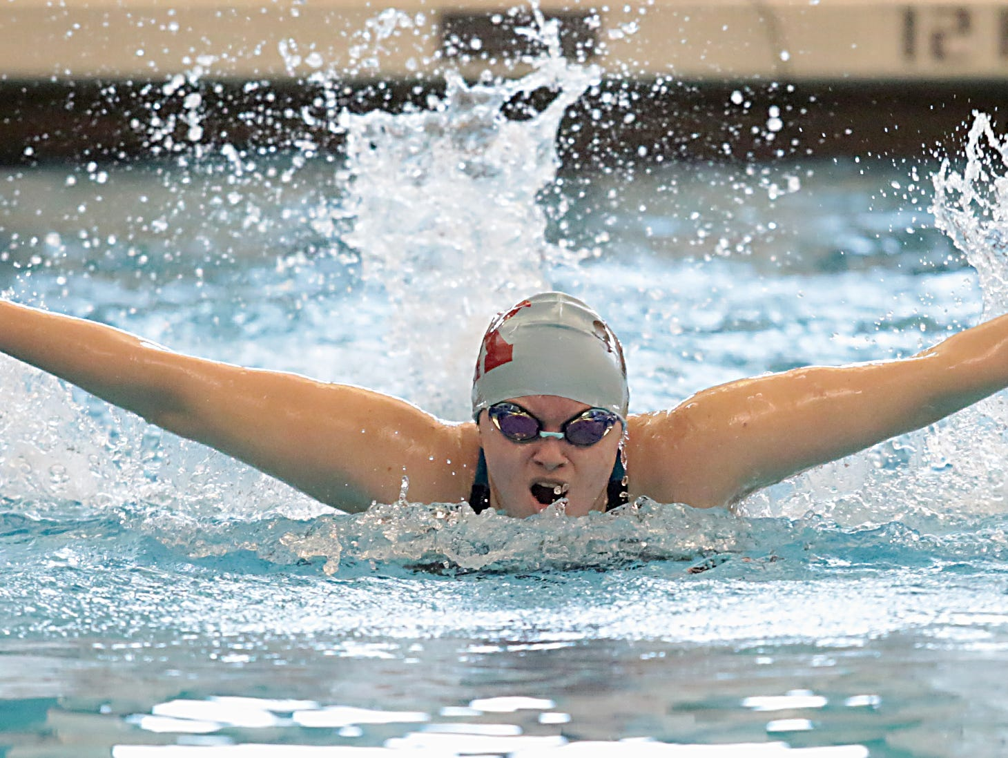 Alicia Barnett, from Kings, competes in the 100-yard butterfly during the Division I and II sectionals at Mason High School Saturday, Feb. 9, 2019.