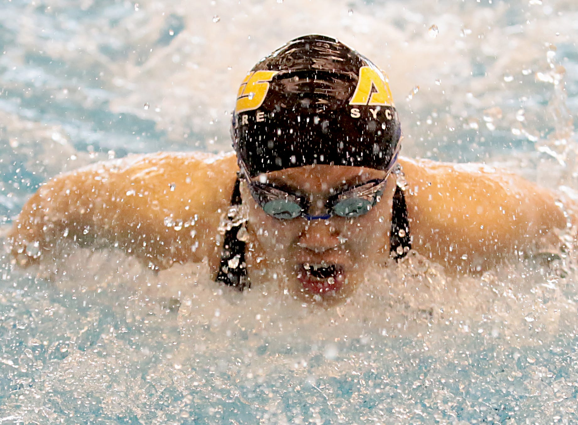 Jessica Lu, from Sycamore, competes in the 100-yard butterfly during the Division I and II sectionals at Mason High School Saturday, Feb. 9, 2019.