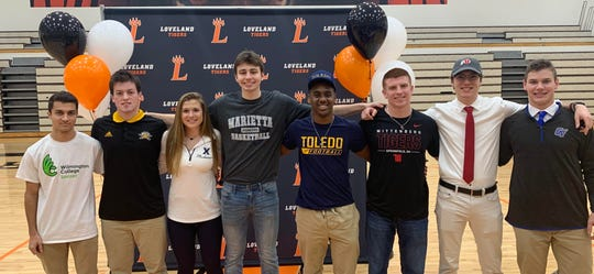 Loveland High School had its Signing Day Feb. 6 ceremony honoring athletes who will play college sports. They are, from left: Andrew Hartman, Josiah Pokopac, Brooke Harden, Jalen Greiser, Natron Webster, Dakota Blum, Kyle Beasley and J.T. Popp.