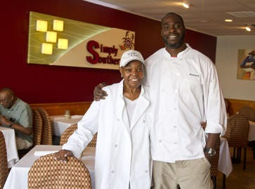 Rasheed Simmons, pictured with his mother Rita, in 2015, at Simply Southern, a restaurant owned by the two in Belmar.