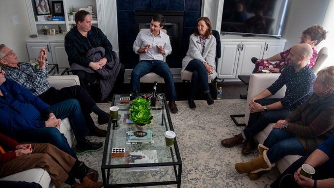 Pete Buttigieg, mayor of South Bend, Ind., answers questions from Iowans on Saturday, Feb. 9, 2018, in the living room of a home in Johnston. Buttigieg is exploring a run for president.