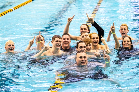 The Ankeny swimming team celebrates in the pool during the Iowa boys' state swimming regional championship meet on Saturday, Feb. 9, 2019, at Campus Recreation and Wellness Center on the University of Iowa campus in Iowa City, Iowa.