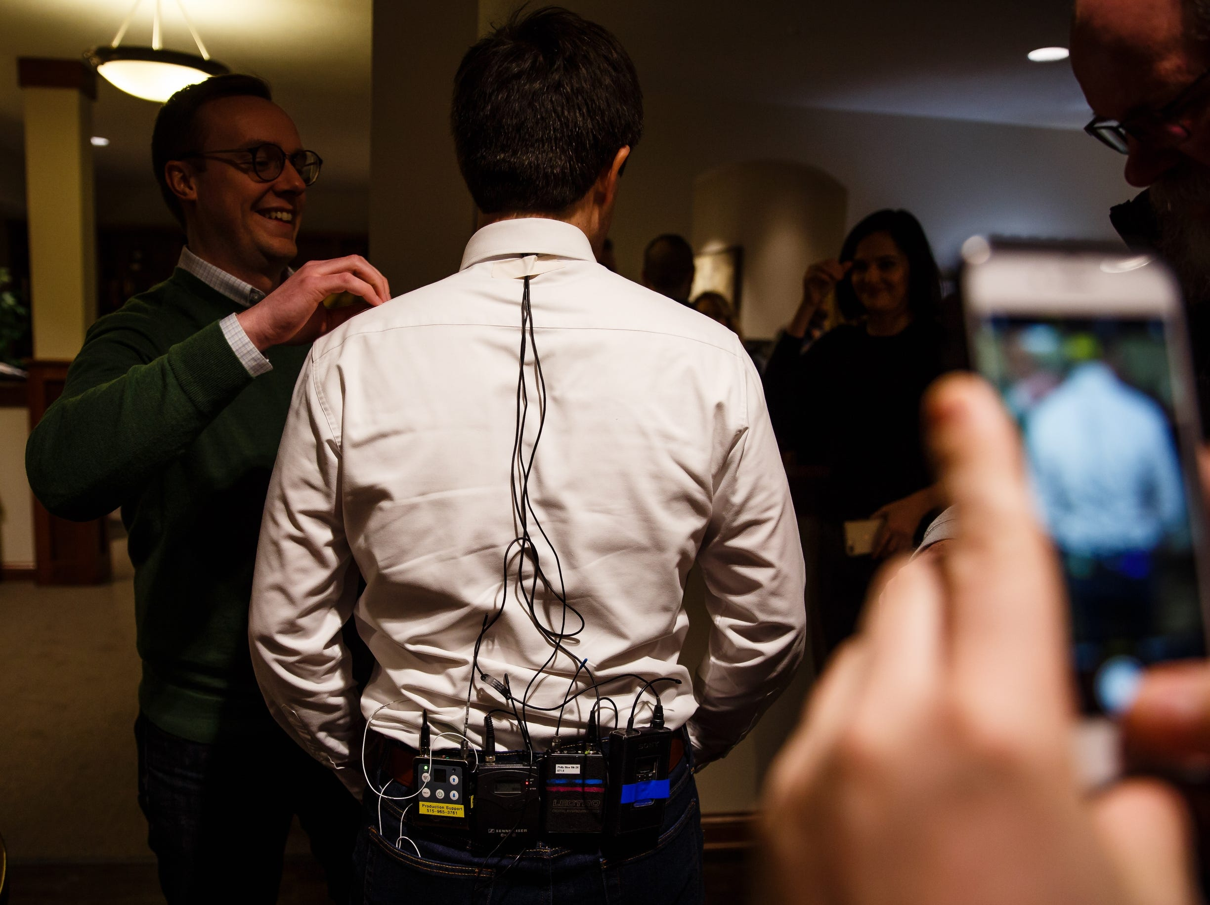 Pete Buttigieg, a 2020 Democratic hopeful, is has microphones put on him before speaking at a campaign event at Vintage Cooperative on Friday, Feb. 8, 2019, in Ankeny.