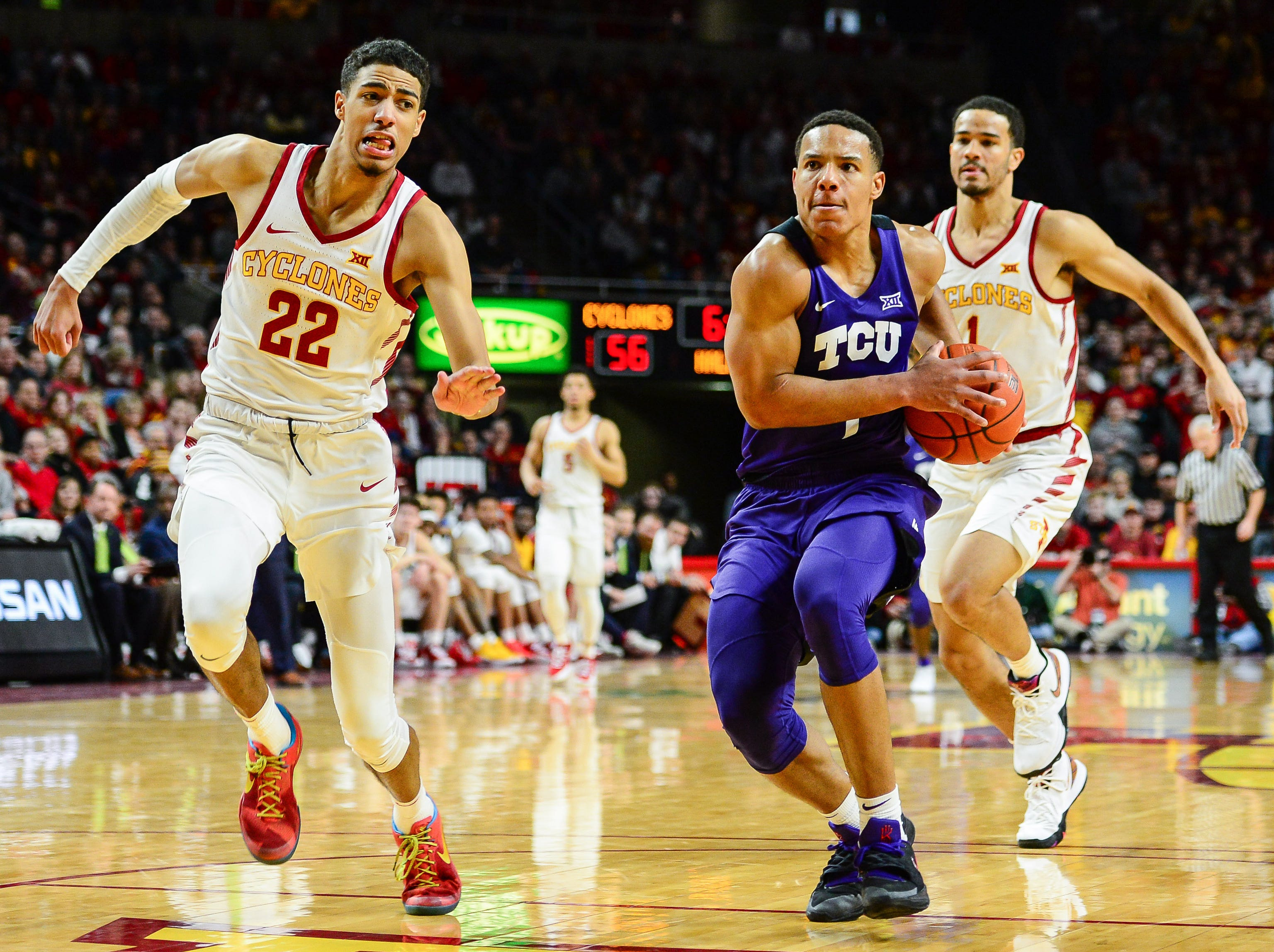 TCU guard Desmond Bane (1) drives to the basket against Iowa State guards Tyrese Haliburton (22) and Nick Weiler-Babb (1) during the second half of their game Saturday, Feb. 9, 2019, at Hilton Coliseum in Ames.