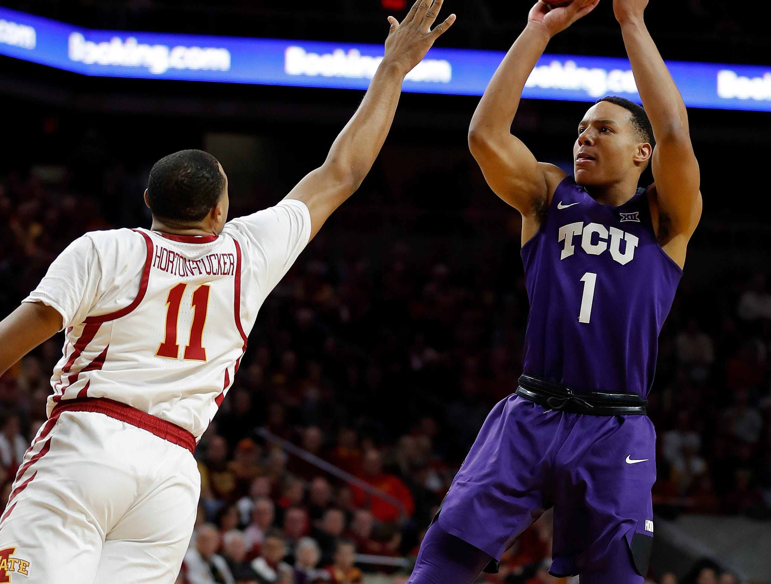 TCU guard Desmond Bane, right, shoots over Iowa State guard Talen Horton-Tucker, left, during their game Saturday, Feb. 9, 2019, in Ames.