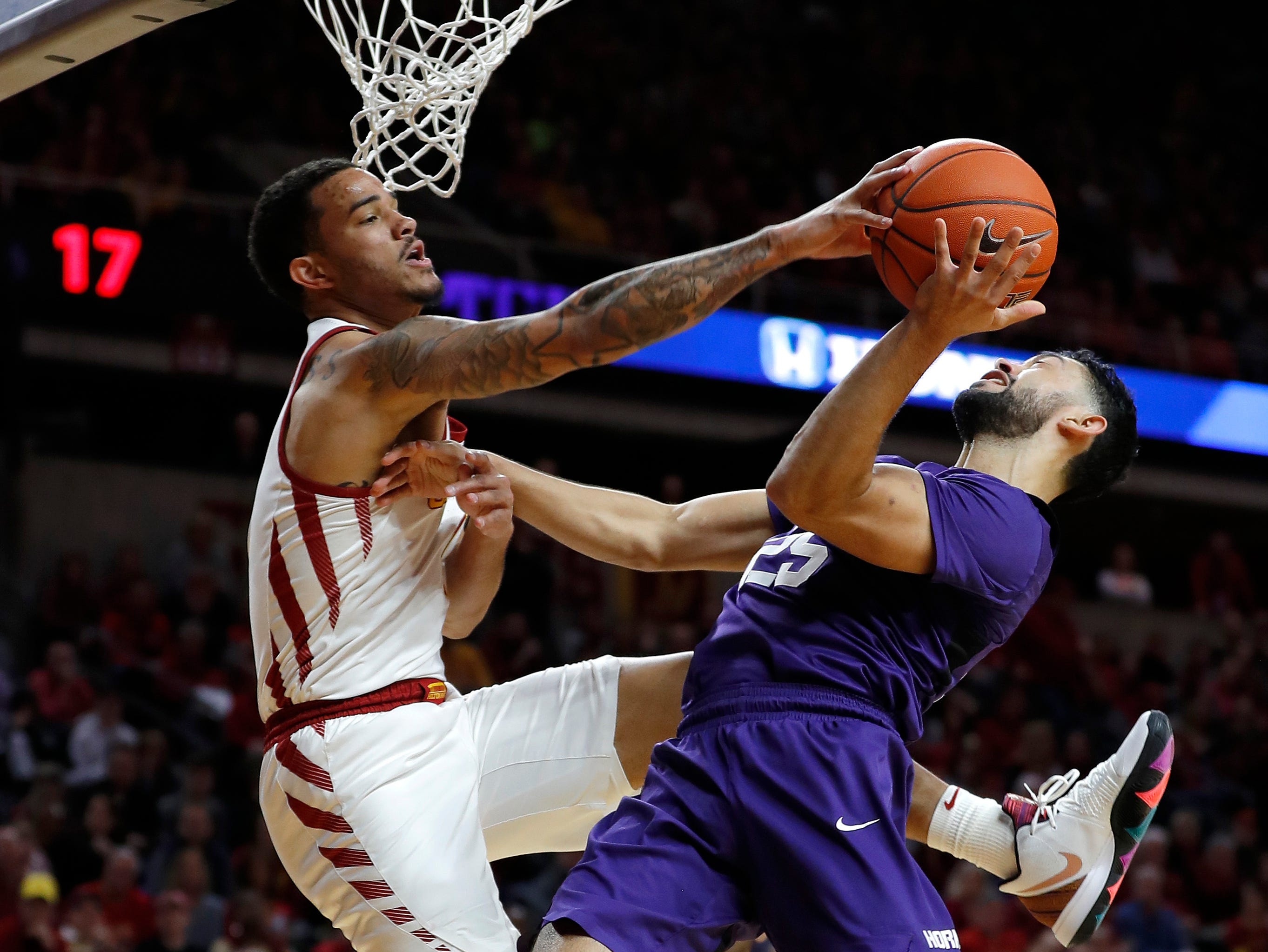 Iowa State guard Nick Weiler-Babb, left, blocks a shot by TCU guard Alex Robinson, right, during their game Saturday, Feb. 9, 2019, in Ames.