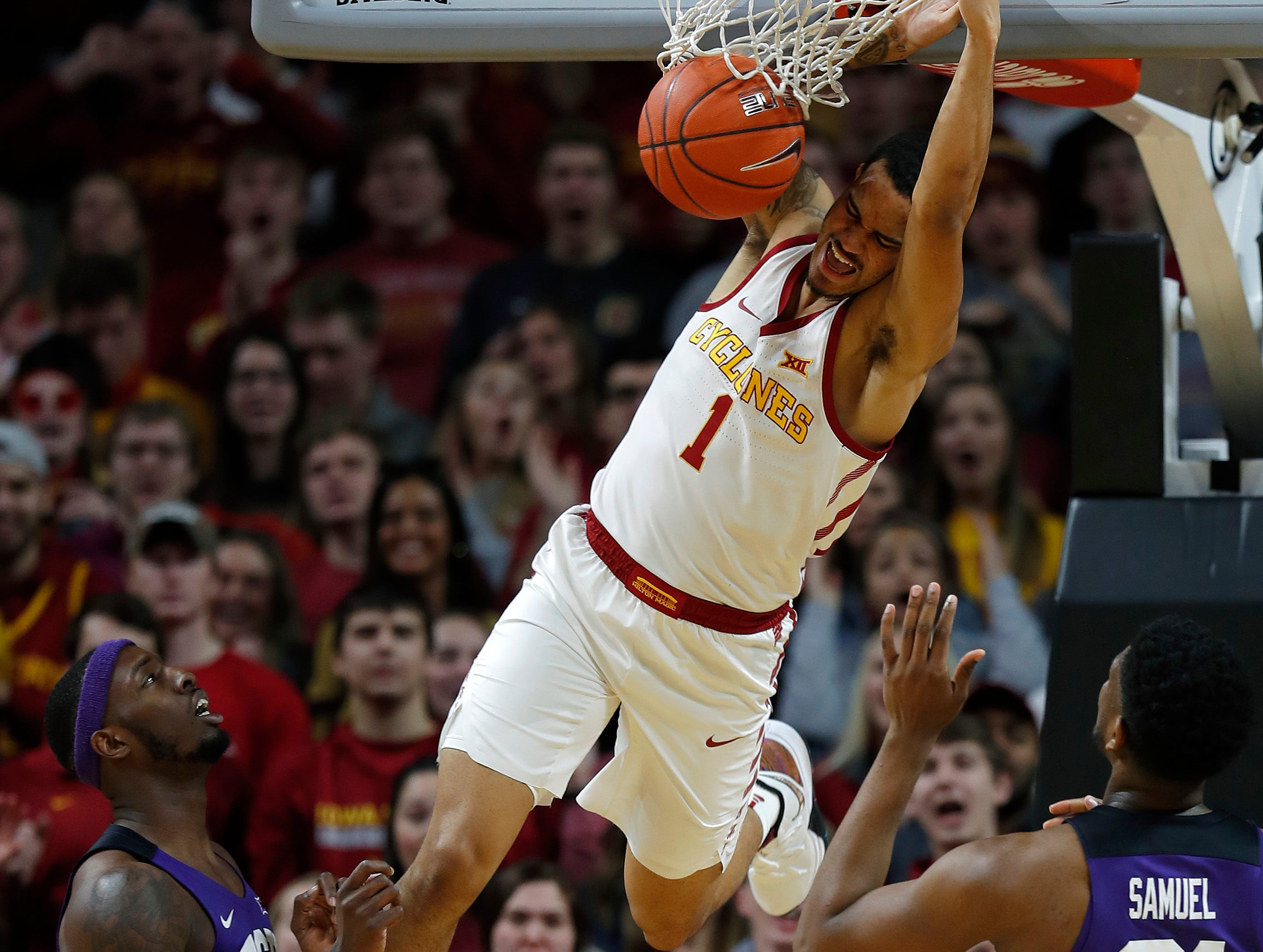 Iowa State guard Nick Weiler-Babb, center, dunks the ball over TCU forward J.D. Miller and TCU center Kevin Samuel, right, during their game Saturday, Feb. 9, 2019, in Ames.