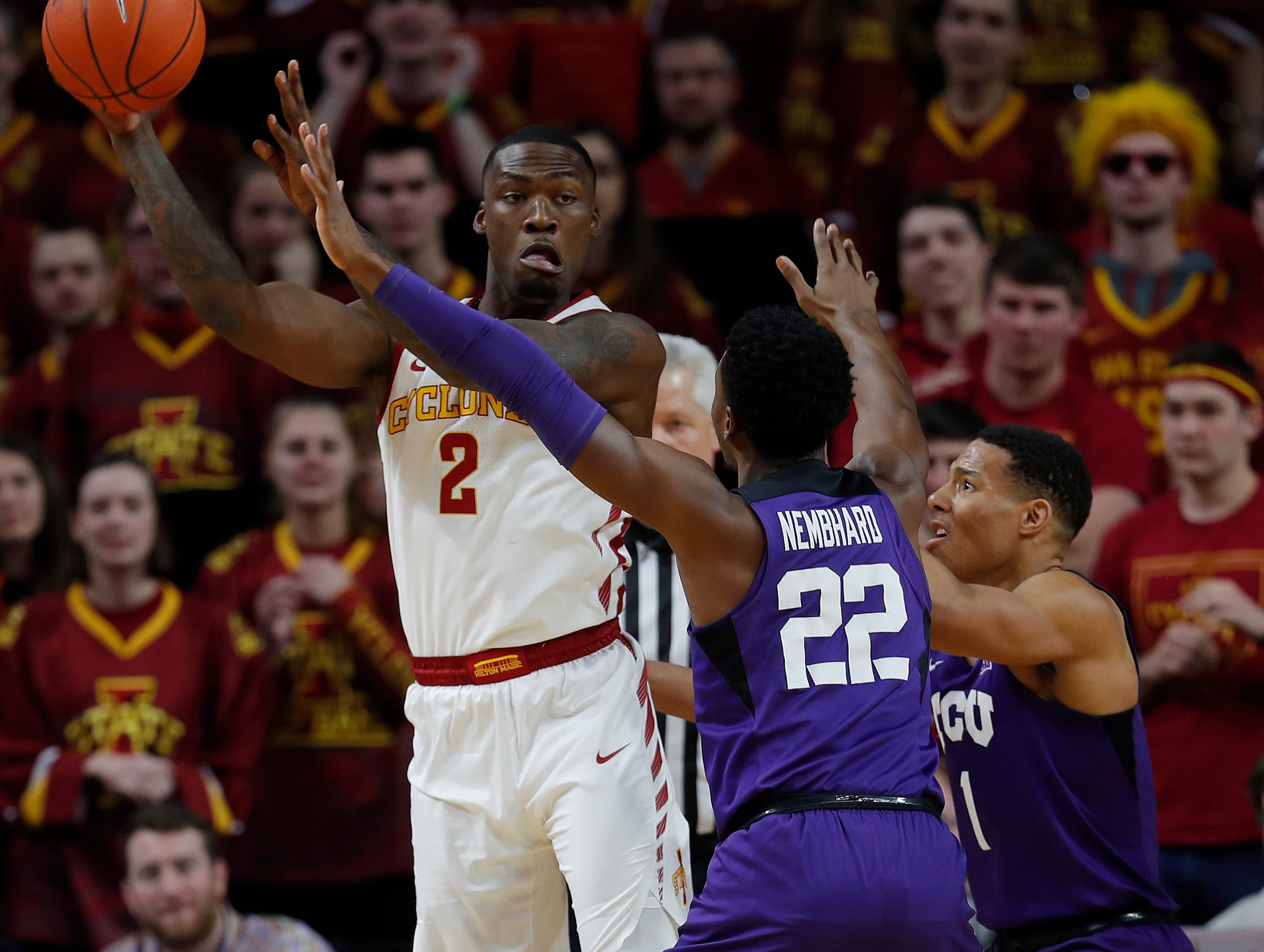 Iowa State forward Cameron Lard, left, tries to get a pass off as TCU guard R.J. Nembhard, center, and TCU guard Desmond Bane, right, defend during their game Saturday, Feb. 9, 2019, in Ames.