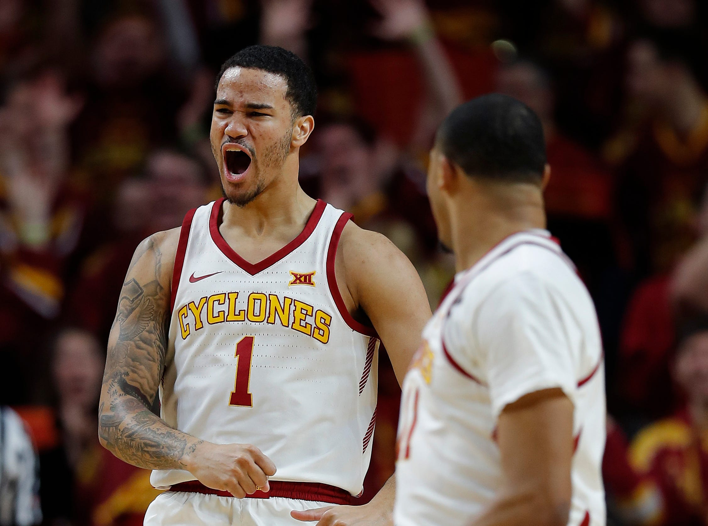 Iowa State guard Nick Weiler-Babb, left, celebrates his dunk with guard Talen Horton-Tucker, right, during their game Saturday, Feb. 9, 2019, in Ames.