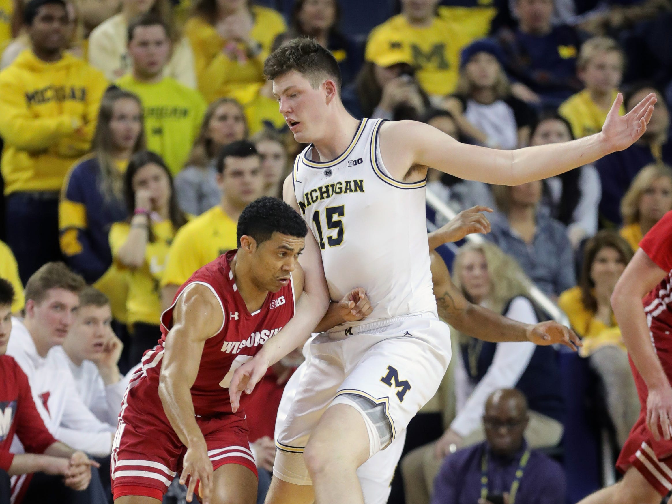 Michigan center Jon Teske defends against Wisconsin guard D'Mitrik Trice during the second half Saturday, Feb. 9, 2019 at the Crisler Center.