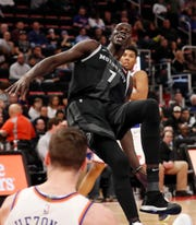 Detroit Pistons center Thon Maker is called for an offensive foul after running into New York Knicks forward Mario Hezonja during the first half Friday, Feb. 8, 2019, in Detroit.