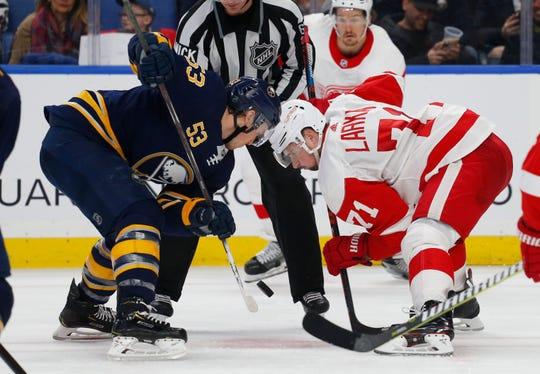 Sabres forward Jeff Skinner and Red Wings forward Dylan Larkin take a faceoff during the third period of the Wings' 3-1 loss on Saturday, Feb. 9, 2019, in Buffalo N.Y.