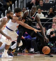 Thon Maker drives against Knicks forward Isaiah Hicks in the fourth period Friday.