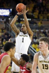 Michigan guard Charles Matthews scores against Wisconsin guard Khalil Iverson during the second half Saturday, Feb. 9, 2019 at Crisler Center.