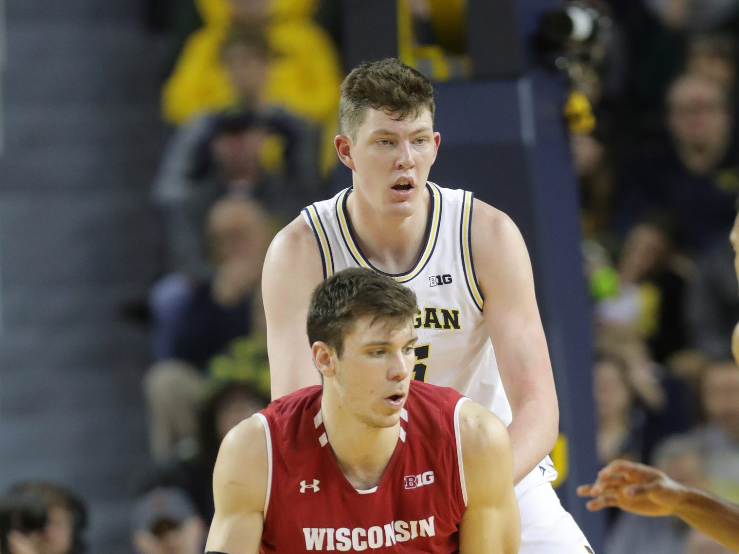 Michigan center Jon Teske defends Wisconsin forward Ethan Happ, Saturday, Feb. 9, 2019 at Crisler Center.