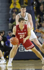 Jon Teske defends Wisconsin's Ethan Happ on Saturday.