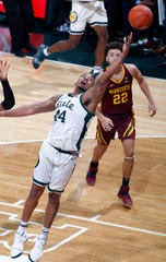 Michigan State's Nick Ward reaches for the ball against Minnesota's Daniel Oturu, left, and Gabe Kalscheur during the first half of MSU's 79-55 win on Saturday, Feb. 9, 2019, in East Lansing.