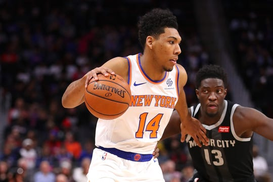 Allonzo Trier #14 of the New York Knicks drives around Khyri Thomas #13 of the Detroit Pistons during the first half at Little Caesars Arena on February 08, 2019 in Detroit, Michigan.