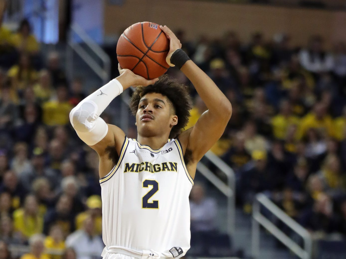 Michigan guard Jordan Poole shoots a three pointer against Wisconsin during the first half Saturday, Feb. 9, 2019 at the Crisler Center.