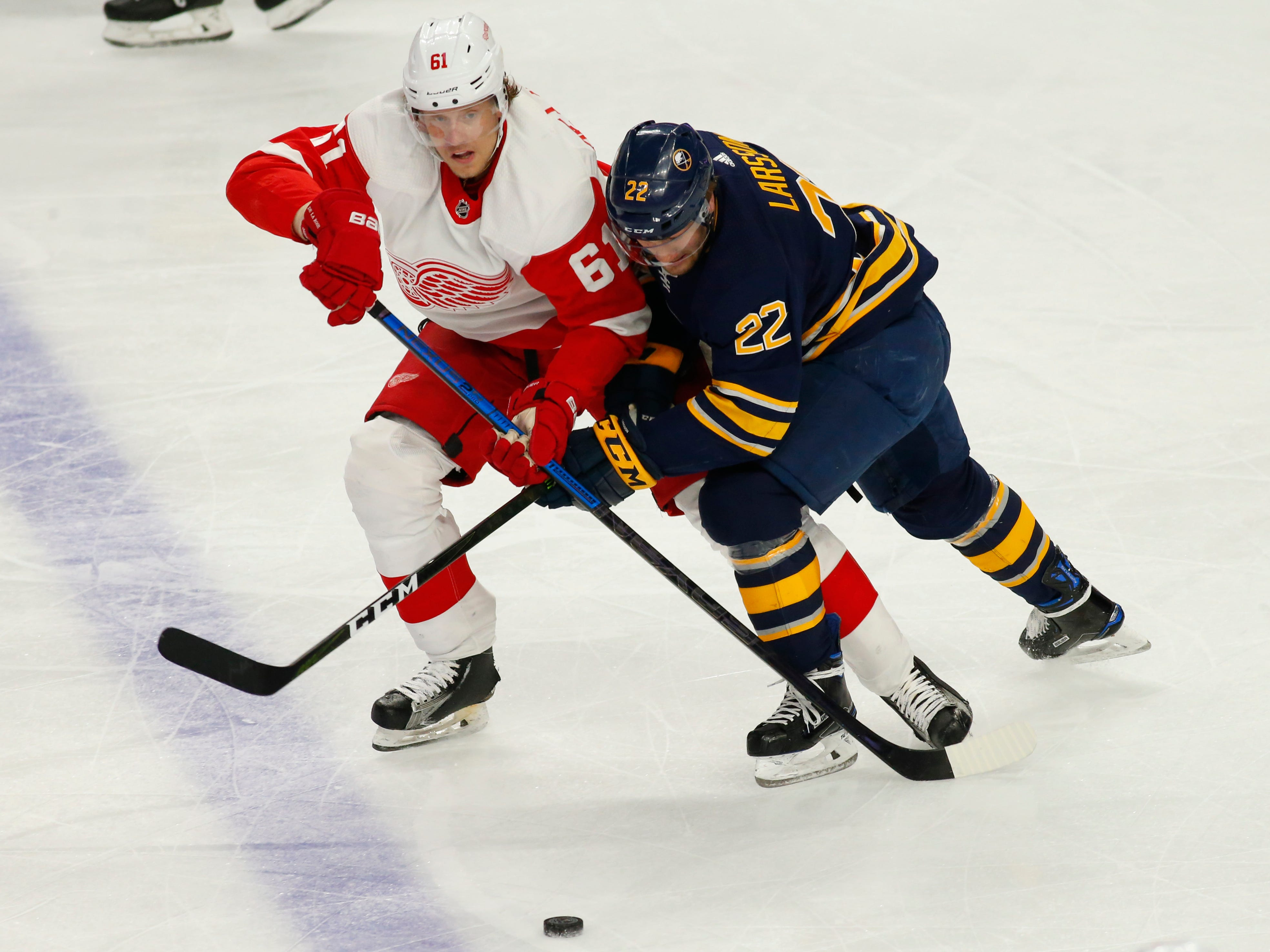 Sabres forward Johan Larsson and Red Wings forward Jacob de la Rose battle for the puck during the first period on Saturday, Feb. 9, 2019, in Buffalo N.Y.