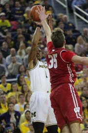 Michigan's Charles Matthews scores against Wisconsin forward Nate Reuvers during the second half Saturday, Feb. 9, 2019 at the Crisler Center.