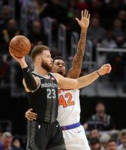 Detroit Pistons forward Blake Griffin passes against New York Knicks forward Lance Thomas, Friday, Feb. 8, 2019 at Little Caesars Arena.