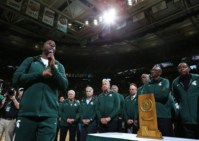 Magic Johnson speaks to the crowd during halftime of the game between Michigan State and Minnesota on Saturday, Feb. 9, 2019, in East Lansing.