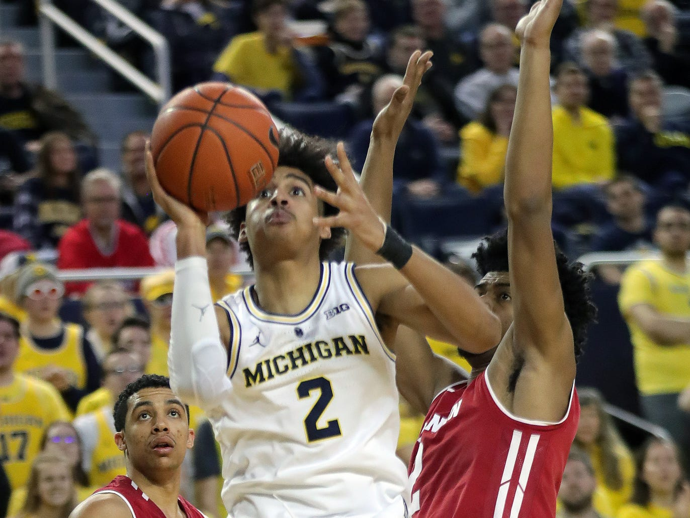 Michigan guard Jordan Poole scores against Wisconsin guard Khalil Iverson during the second half Saturday, Feb. 9, 2019 at Crisler Center.