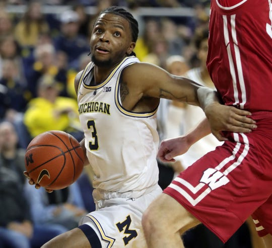 Zavier Simpson drives against Wisconsin on Feb. 9 at Crisler Center.