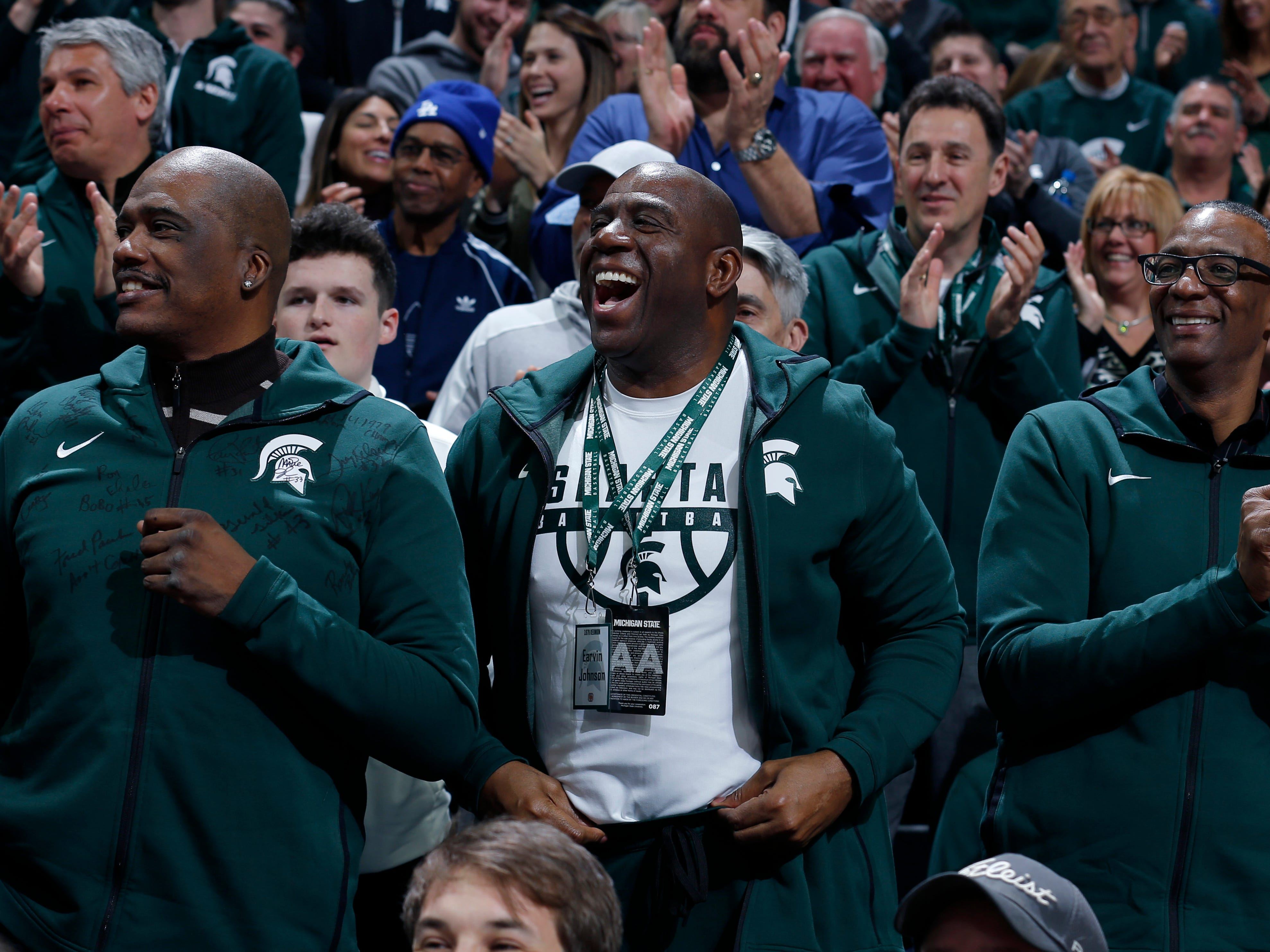 Former players on Michigan State's 1979 national championship team, including Jay Vincent, left, Magic Johnson, center, and Greg Kelser, right, on Saturday, Feb. 9, 2019, in East Lansing.
