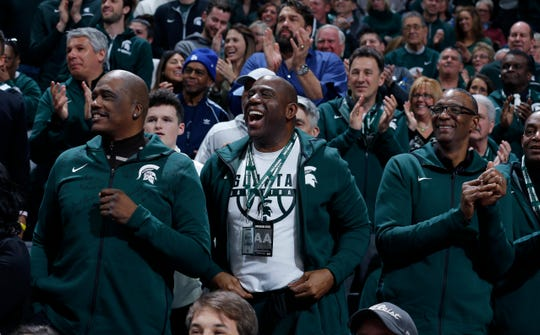 Former players on Michigan State's 1979 national championship team, including Jay Vincent, left, Magic Johnson, center, and Greg Kelser, right, on Saturday in East Lansing.